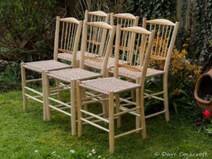 Set of 6 dining chairs in ash and cherry with danish cord seats