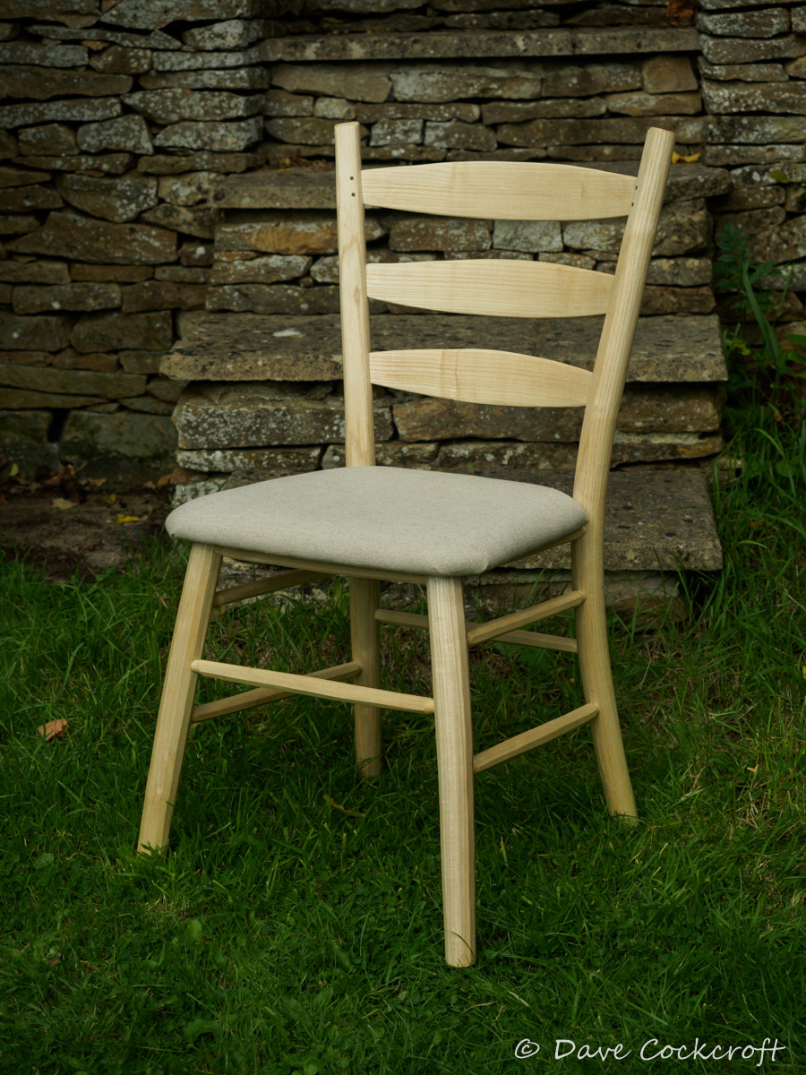 Contemporary ladderback with upholstered seat.