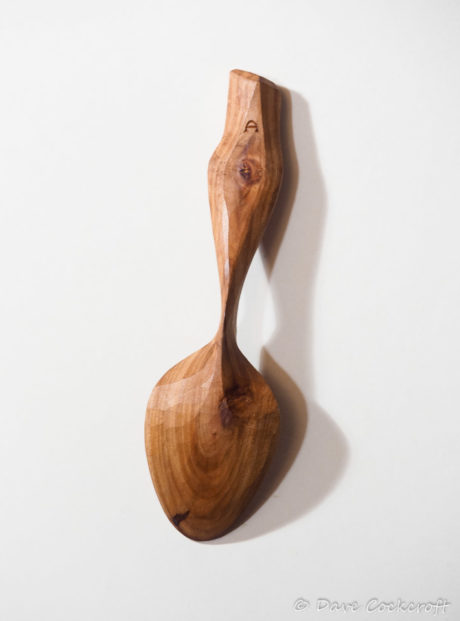 Apple wood eating spoon with eagle eye handle