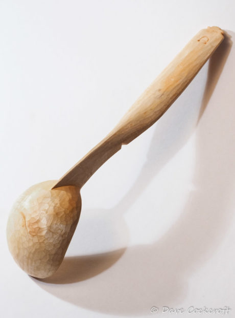 ladle with folk art decorated handle