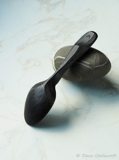 ebonised spoon on pebble-18