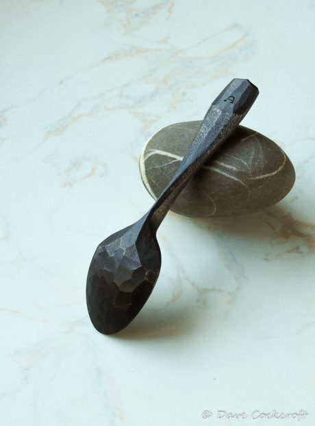 ebonised spoon on pebble-26