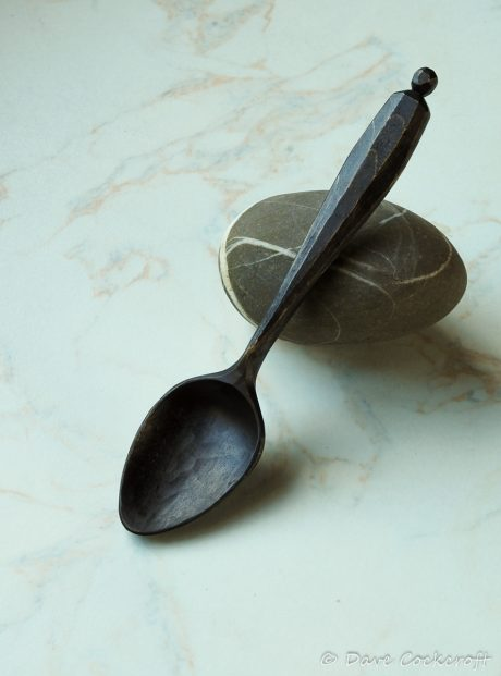ebonised spoon on pebble-31