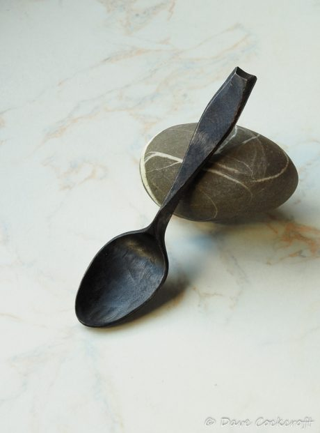 ebonised spoon on pebble-33