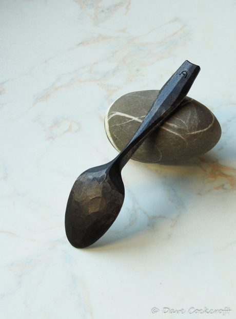 ebonised spoon on pebble-34