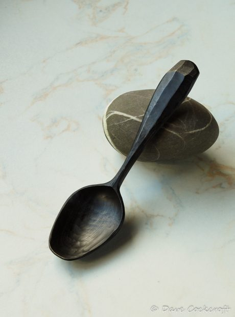 ebonised spoon on pebble-39