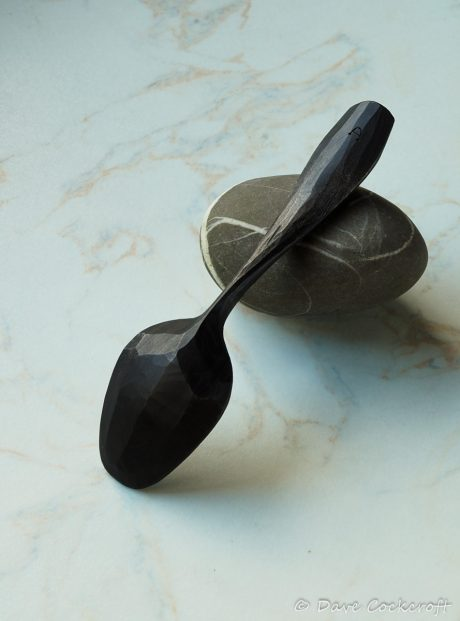ebonised spoon on pebble-40